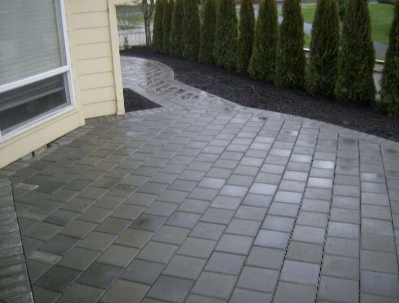 patio pavers over concrete. The Water Running Through And Over Patio Pavers Concrete
