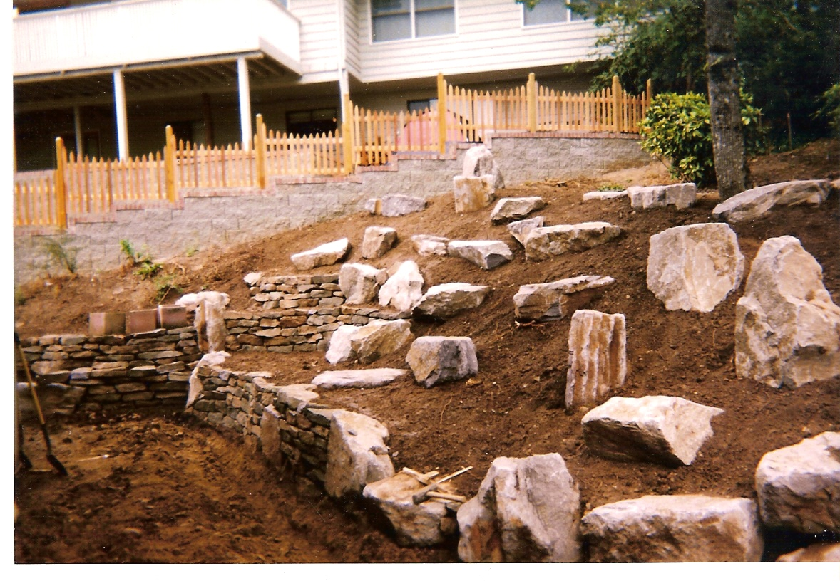 Artists and artisans steve snedeker s landscaping and for Landscaping with rocks and boulders